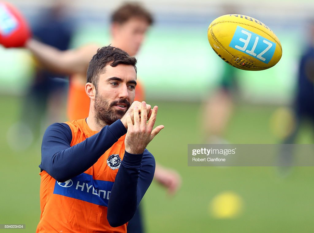 Kade Simpson of the Blues handballs during a Carlton Blues AFL training session at Ikon Park on May 25, 2016 in Melbourne, Australia.