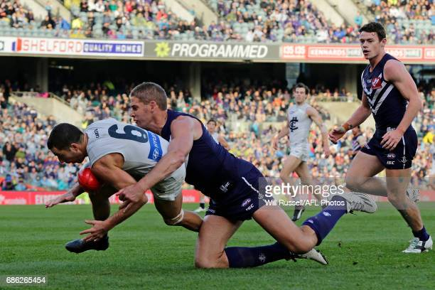 Kade Simpson of the Blues is tackled by Aaron Sandilands of the Dockers during the round nine AFL match between the Fremantle Dockers and the Carlton...