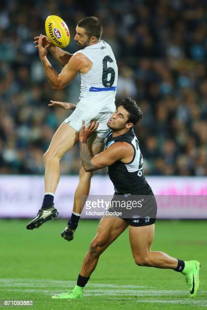 Kade Simpson of the Blues marks the ball against Chad Wingard of the Power during the round five AFL match between the Port Adelaide Power and thew...