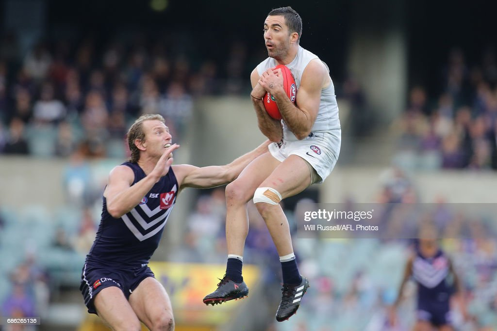 Kade Simpson of the Blues marks the ball during the round nine AFL match between the Fremantle Dockers and the Carlton Blues at Domain Stadium on May 21, 2017 in Perth, Australia.