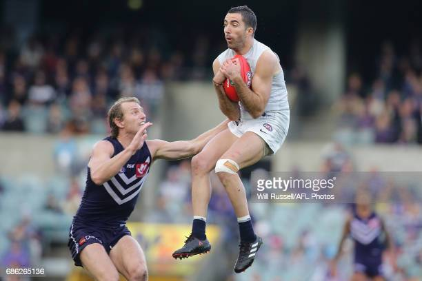 Kade Simpson of the Blues marks the ball during the round nine AFL match between the Fremantle Dockers and the Carlton Blues at Domain Stadium on May...