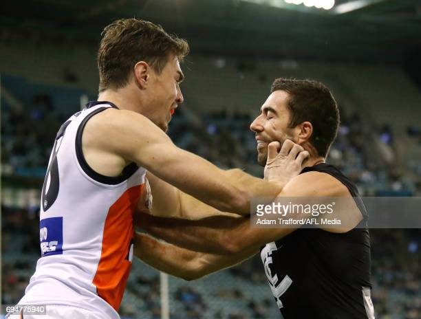 Kade Simpson of the Blues remonstrates with Jeremy Cameron of the Giants after he laid a bump on Jed Lamb of the Blues during the 2017 AFL round 12...