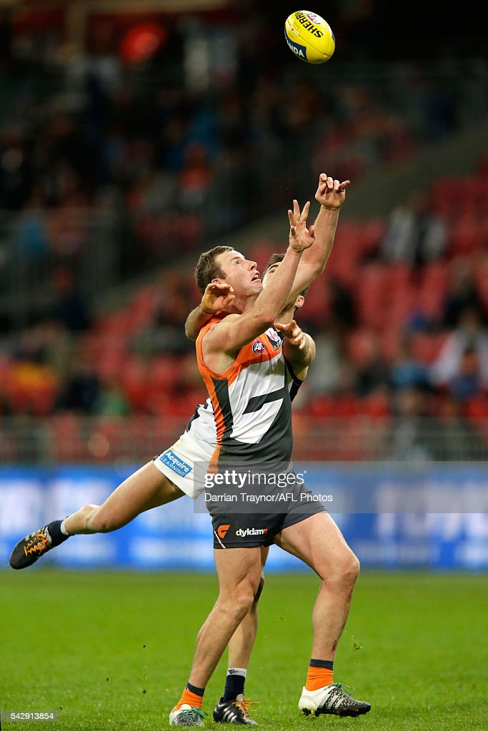 Kade Simpson of the Blues spoils Steve Johnson of the Giants during the round 14 AFL match between the Greater Western Sydney Giants and the Carlton Blues at Spotless Stadium on June 25, 2016 in Sydney, Australia.