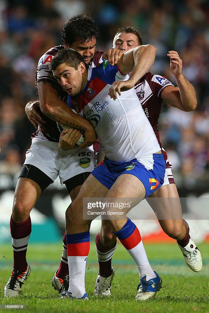Kade Snowden of the Knights is tackled during the round two NRL match between the Manly Sea Eagles and the Newcastle Knights at Brookvale Oval on March 17, 2013 in Sydney, Australia.