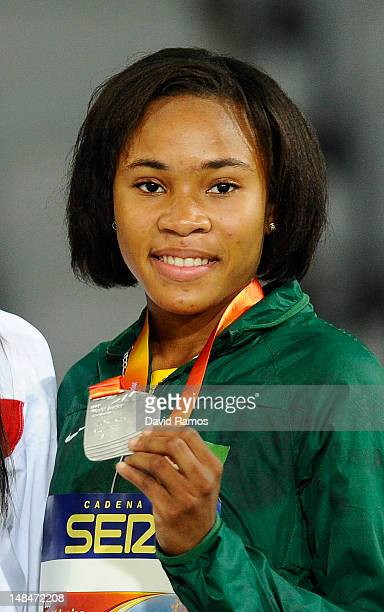 Kadecia Baird of Guyana pose on the podium during the medals ceremony of the Women's 400 metres Final on the day four of the 14th IAAF World Junior...