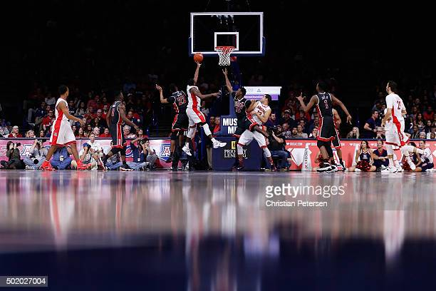 Kadeem Allen of the Arizona Wildcats lays up a shot past Patrick McCaw of the UNLV Rebels during the second half of the college basketball game at...