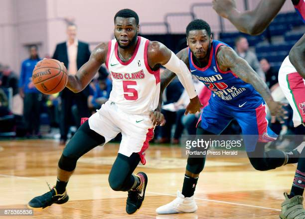 Kadeem Allen of the Maine Red Claws drives to the basket as Dwight Buycks plays defense for Grand Rapids Thursday November 16 2017