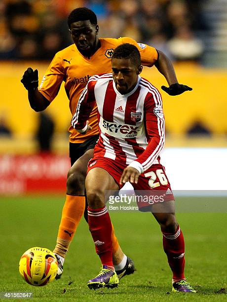 Kadeem Harris of Brentford holds off the challenge of Bakary Sako Wolves during the Sky Bet League One game between Wolverhampton Wanderers and...