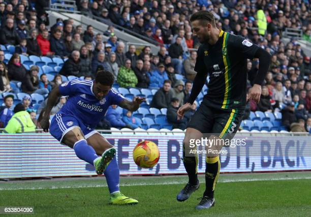 Kadeem Harris of Cardiff City crosses the ball into the box past the challenging Mitchell Dijks of Norwich City during the Sky Bet Championship match...