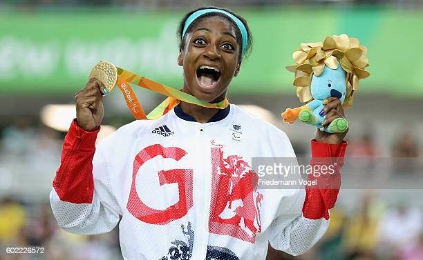 Kadeena Cox of Great Britain celebrates on the podium after winning Women's C45 500m Time Trial track cycling on day 3 of the Rio 2016 Paralympic...