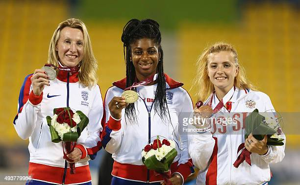 Kadeena Cox of Great Britain poses with gold Georgina Hermitage silver and Anna Sapozhinikova of Russia bronze after the women's 100m T37 final...