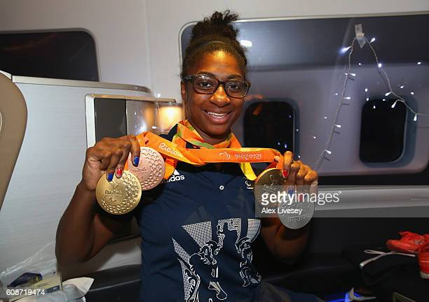 Kadeena Cox of the Paralympics GB Team poses with her medals onboard the British Airways flight BA2016 from Rio to Heathrow Airport on September 20...