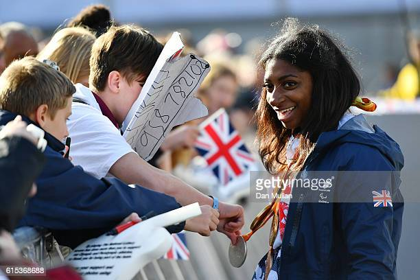 Kadeena Cox speaks to the spectators during the Olympics Paralympics Team GB Rio 2016 Victory Parade at Trafalgar Square on October 18 2016 in London...