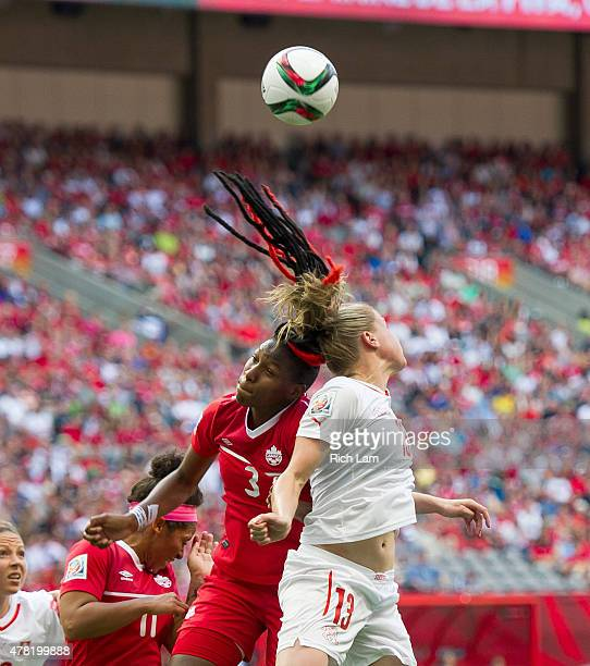 Kadeisha Buchanan of Canada and AnaMaria Crnogorcevic of Switzerland go up for a loose ball during the FIFA Women's World Cup Canada 2015 Round of 16...