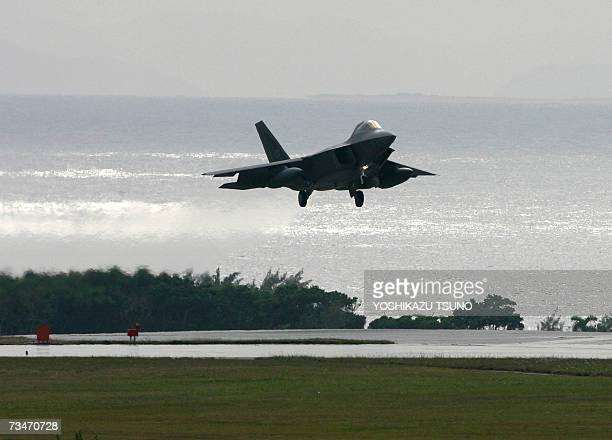 A US Air Force's new stealth fighter F22A Raptor lands at Kadena US Air Base in Kadena town southern island of Okinawa 18 February 2007 Two US air...