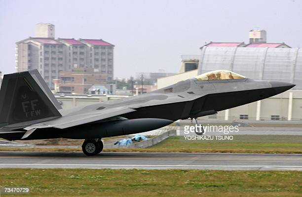 US Air Force's new stealth fighter F22A Raptor arrives at Kadena US Air Base in Kadena town southern island of Okinawa 18 February 2007 Two US air...