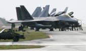 US Air Force's new stealth fighters F22A Raptor are lined up at the Kadena US Air Base in Kadena town southern island of Okinawa 18 February 2007 Two...
