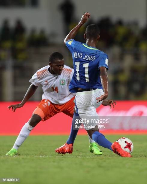 Kader Aboubacar of Niger hallenges Vinicius Jr of Brazil during the FIFA U17 World Cup India 2017 group C match between Niger and Brazil at Pandit...