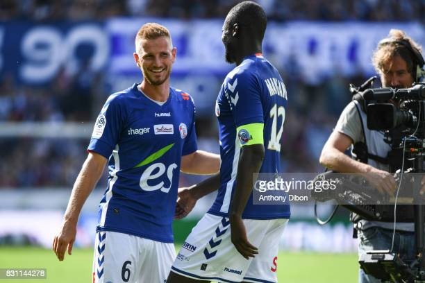 Kader Mangane and Jeremy Grimm of Strasbourg celebrates the victory during the Ligue 1 match between Racing Club Strasbourg and Lille OSC at Stade de...