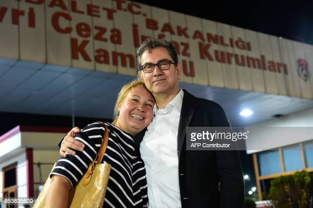 Kadri Gursel embraces his wife after being freed from Silivri prison on September 26 2017 in Istanbul following a Turkish court order to free the...