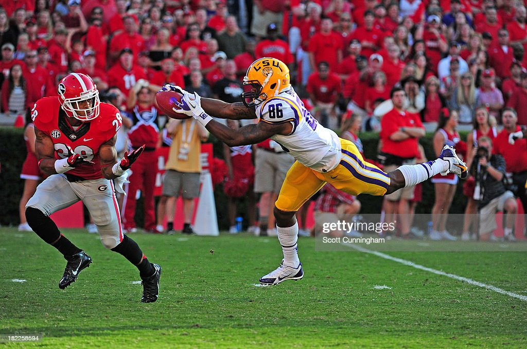 Kadron Boone #86 of the LSU Tigers makes a catch against Tray Matthews #28 of the Georgia Bulldogs at Sanford Stadium on September 28, 2013 in Athens, Georgia.