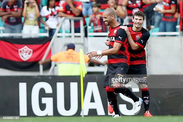 Kadu of Vitoria is mobbled by his team mates after scoring their goal during the match between Vitoria and Bahia as part of Brasileirao Series A 2014...