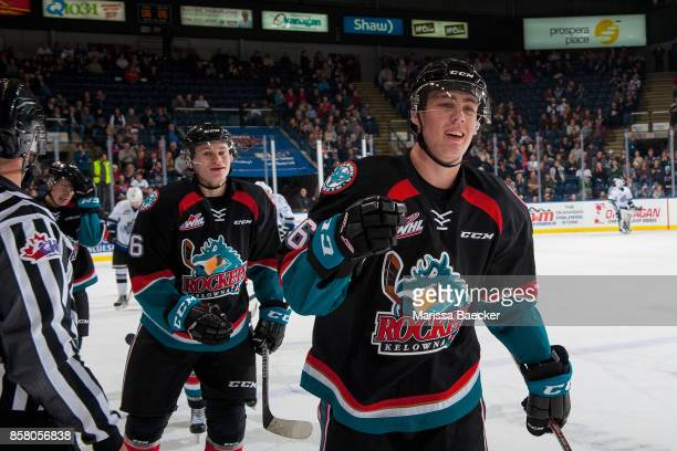 Kaedan Korczak and Kole Lind of the Kelowna Rockets skate to the bench to celebrate a first period goal against the Victoria Royals at Prospera Place...