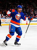 Kael Mouillierat of the New York Islanders celebrates after scoring his first career NHL goal in the third period of a game against the Arizona...