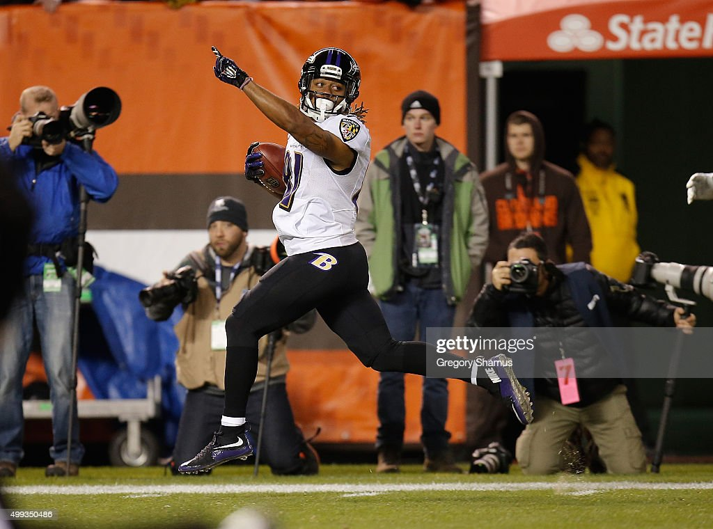 Kaelin Clay #81 of the Baltimore Ravens celebrates his punt return for a touchdown during the first quarter against the Cleveland Browns at FirstEnergy Stadium on November 30, 2015 in Cleveland, Ohio.