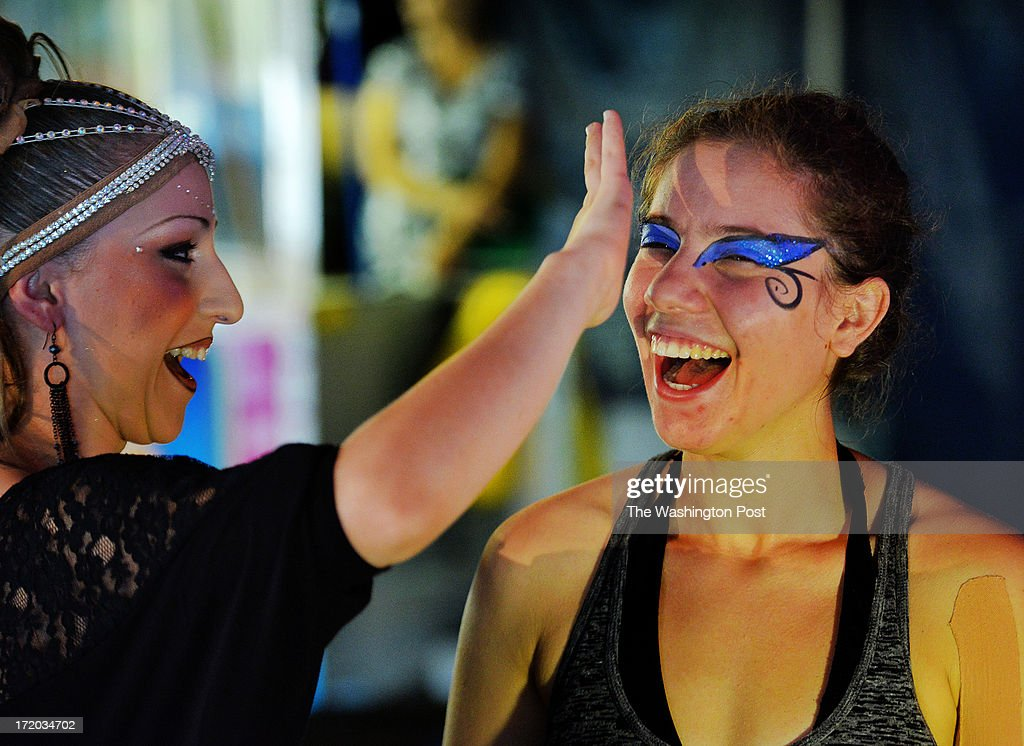 Kaely Michels Gualtieri, 23, right, has makeup applied by fellow performer Corissa Fusco, left, before she performs her aerial act in the Cirque Italia on June, 30, 2013 in Manassas, VA.