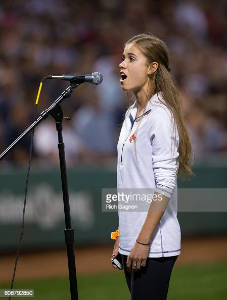Kaetlyn Arant of Amherst Massachusetts sings the national anthem before a game between the Boston Red Sox and the New York Yankees at Fenway Park on...