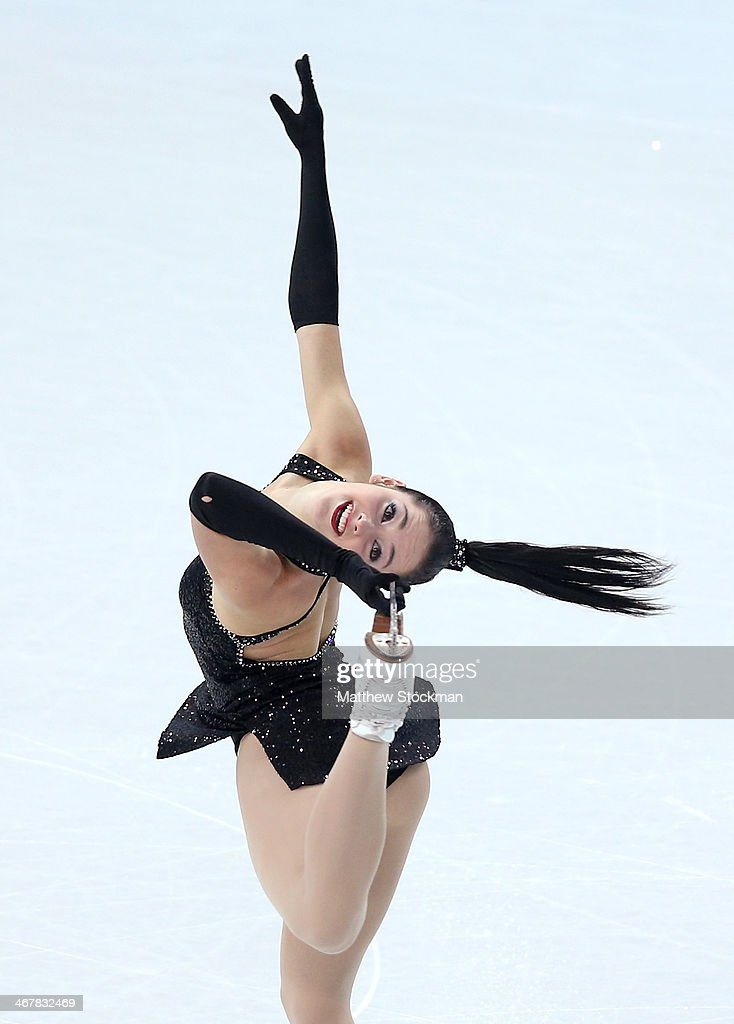 <a gi-track='captionPersonalityLinkClicked' href=/galleries/search?phrase=Kaetlyn+Osmond&family=editorial&specificpeople=9891099 ng-click='$event.stopPropagation()'>Kaetlyn Osmond</a> of Canada competes in the Figure Skating Team Ladies Short Program during day one of the Sochi 2014 Winter Olympics at Iceberg Skating Palace on February 8, 2014 in Sochi, Russia.
