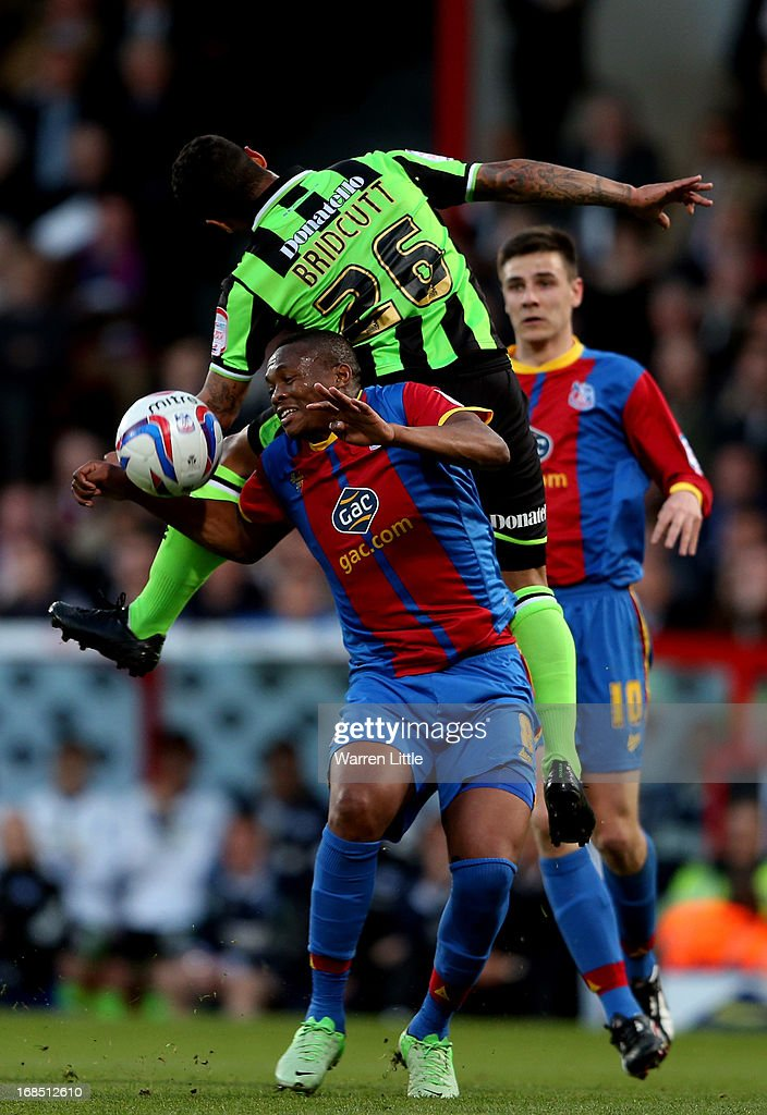 Kagisho Dikgacoi of Crystal Palace is challenged by Liam Bridcutt of Birghton & Hove Albion during the npower Championship play off semi final first leg at Selhurst Park on May 10, 2013 in London, England.