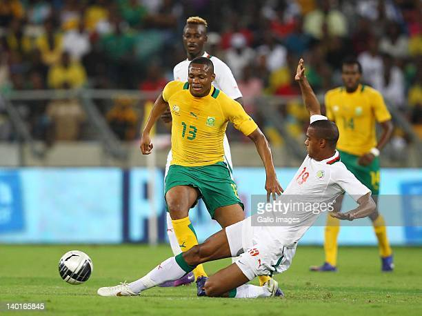 Kagisho Dikgacoi of South Africa is tackled by Ricardo Faty of Senegal during the International Friendly match between South Africa and Senegal at...