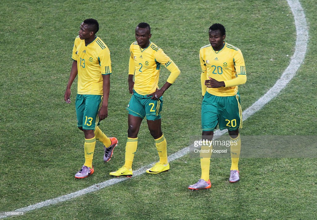 Kagisho Dikgacoi Siboniso Gaxa and Bongani Khumalo of South Africa look dejected after drawing the 2010 FIFA World Cup South Africa Group A match...