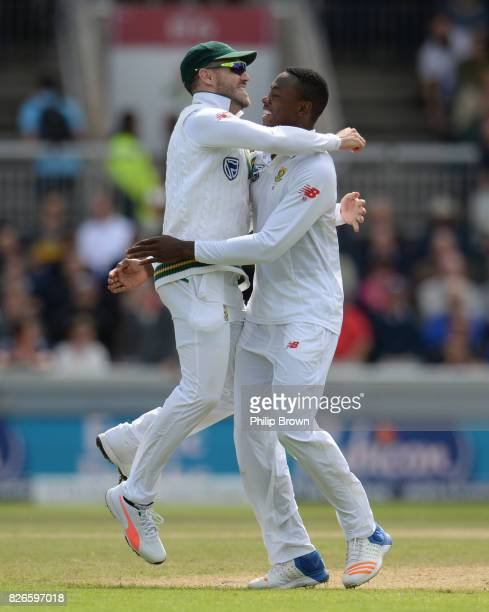 Kagiso Rabada and Faf du Plessis of South Africa velebrate after the dismissal of Moeen Ali on the second day of the 4th Investec Test match between...