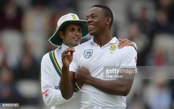Kagiso Rabada is congratulated by Keshav Maharaj of South Africa after the dismissal of Keaton Jennings of England during the third day of the 4th...