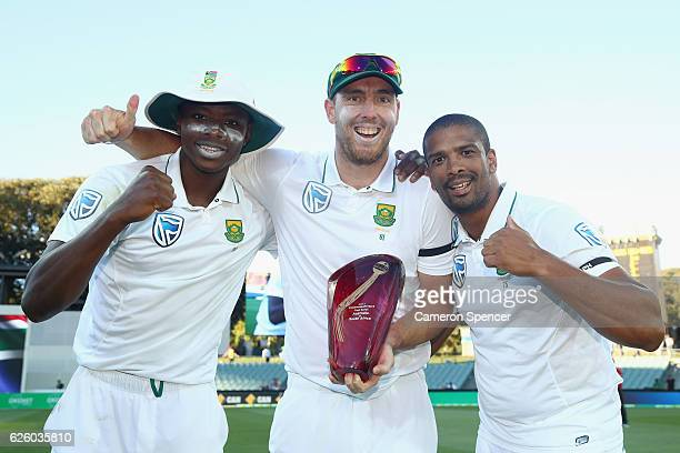 Kagiso Rabada Kyle Abbott and Vernon Philander of South Africa celebrate after winning the series 21 during day four of the Third Test match between...