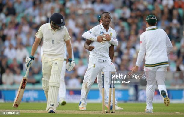 Kagiso Rabada of South Africa celebrates after bowling Dawid Malan of England during the first day of the 3rd Investec Test match between England and...