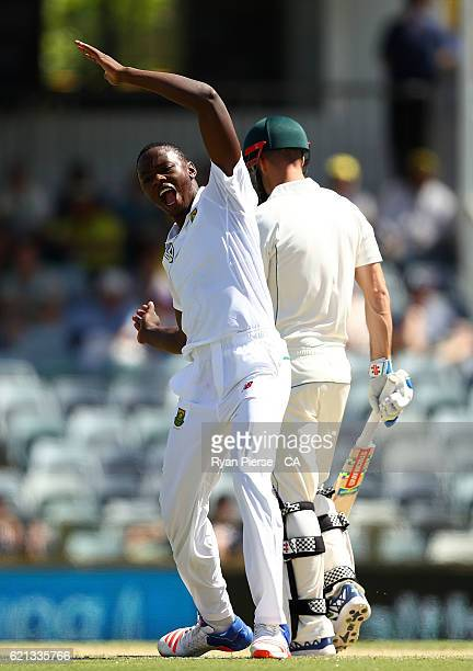 Kagiso Rabada of South Africa celebrates after taking the wicket of Shaun Marsh of Australia during day four of the First Test match between...