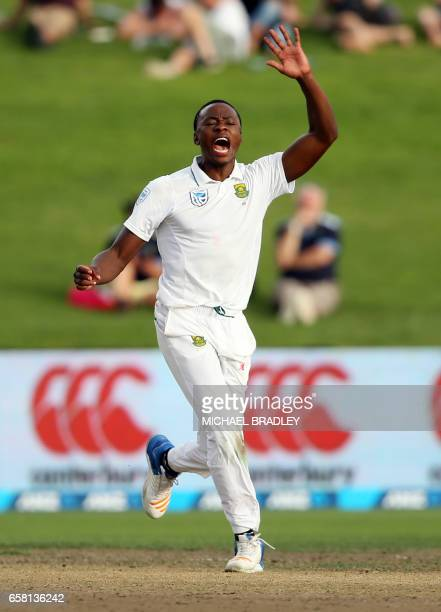 Kagiso Rabada of South Africa celebrates the wicket of New Zealand's Neil Broom during day three of the third Test cricket match between New Zealand...