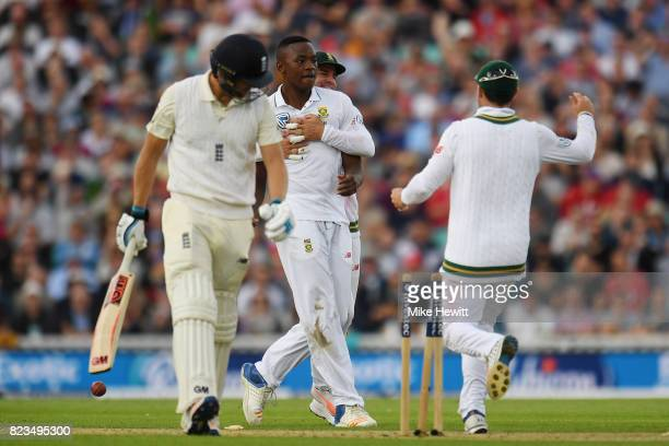 Kagiso Rabada of South Africa celebrates with team mates after bowling Dawid Malan of England during Day One of the 3rd Investec Test between England...