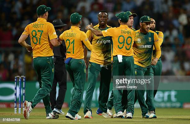 Kagiso Rabada of South Africa celebrates with teammates after dismissing Ben Stokes of England during the ICC World Twenty20 India 2016 Super 10s...