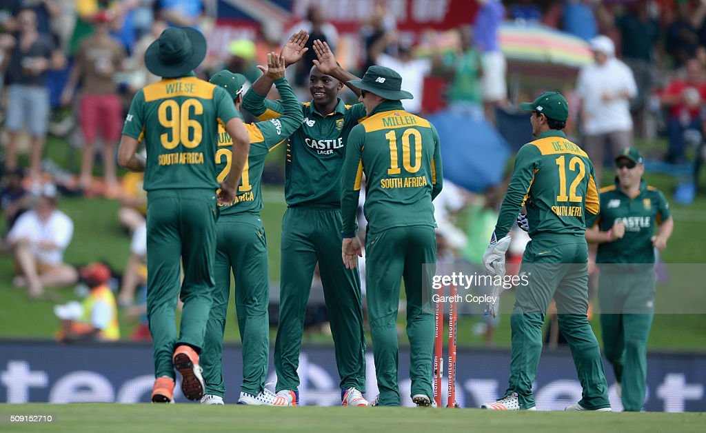 Kagiso Rabada of South Africa celebrates with teammates after dismissing Jos Buttler of England during the 3rd Momentum ODI match between South Africa and England at Supersport Park on February 9, 2016 in Centurion, South Africa.