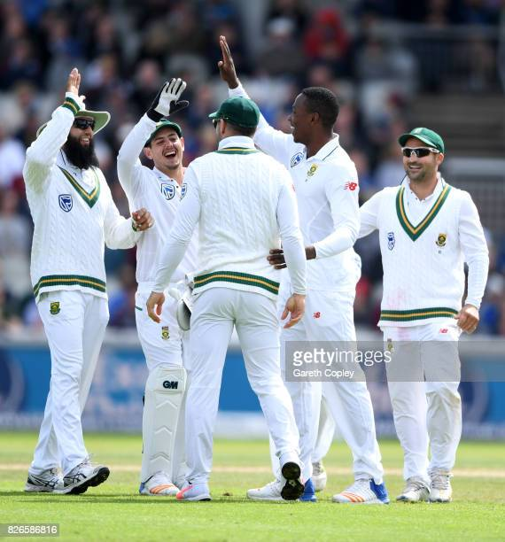 Kagiso Rabada of South Africa celebrates with teammates after dismissing Moeen Ali of England during day two of the 4th Investec Test between England...