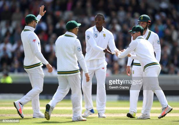 Kagiso Rabada of South Africa celebrates with teammates after dismissing Toby RolandJones of England during day two of the 4th Investec Test between...