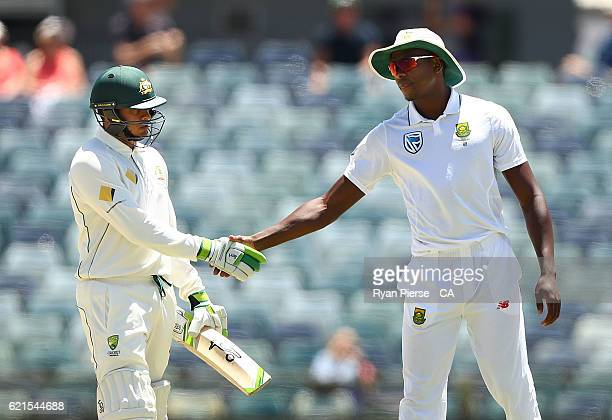 Kagiso Rabada of South Africa congratulates Usman Khawaja of Australia after he was dismissed for 97 runs by JeanPaul Duminy of South Africa during...
