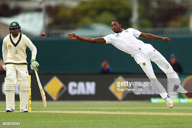 Kagiso Rabada of South Africa fields the ball off his own bowling during day three of the Second Test match between Australia and South Africa at...