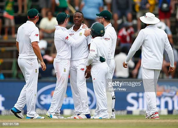 Kagiso Rabada of South Africa is congratulated after bowling out Stuart Broad of England during day three of the 3rd Test at Wanderers Stadium on...
