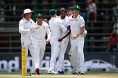 Kagiso Rabada of South Africa is congratulated after taking the wicket of Alex Hales of England during day two of the 3rd Test at Wanderers Stadium...